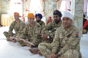 Delegation gracefully listens to Guru Granth Sahib Ji's message in the Gurudwara