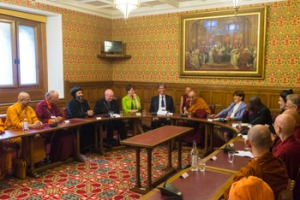 His Holiness the Dalai Lama and fellow participants during an interfaith meeting. Photo by Ian Cumming