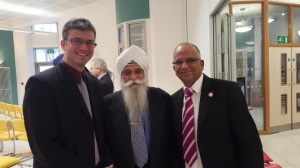 Jewish (Lior), Sikh (Mr Mandla) and Jain (Arvinder) friends have a catch-up and a group photo
