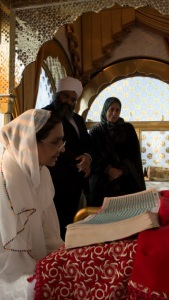 Dr Marzouk listens as prayers are recited from Sri Guru Granth Sahib Ji in the Gumbad Darbar (Dome Prayer Room)