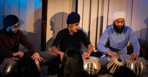 "The Leeds ""Tabla Trio"" performing in front of a delighted audience."