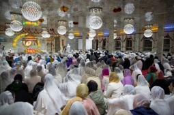 The Sangat (congregation) listen to prayers being recited from Sri Guru Granth Sahib Ji