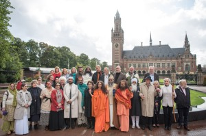 Interfaith leaders standing together in front of the International Peace Palace, The Hague