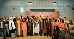 Interfaith leaders joining hands together at the Universal Sufi Temple, Katwijk.