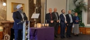Amrick Singh, speaks on behalf of, and accompanied by, some members of the Birmingham Faith Leaders Group