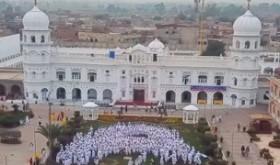 A group photo outside Nankana Sahib Gurudwara